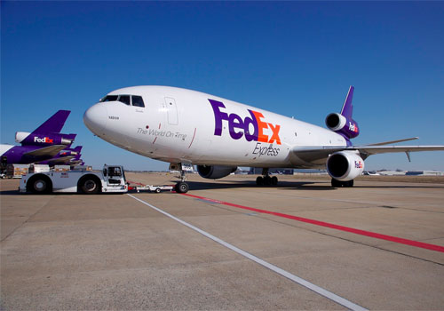 FedEx pension charges bring about a loss in fourth quarter