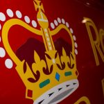 Royal Mail profits fall by more than half